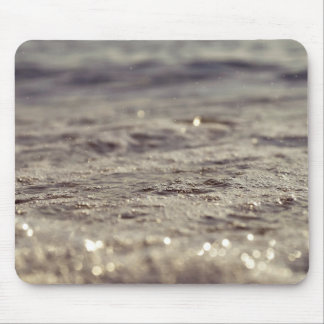 Sparkling bubbles of foam on the surface of water mouse pad