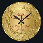"Sparkling Gold 50th Wedding Anniversary Large Clock<br><div class=""desc"">Elegant gold tones floral border with 2 hearts ,  Gold 50th Wedding Anniversary. It comes in silver tones.</div>"