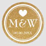 "Sparkly gold monogram wedding favor stickers seals<br><div class=""desc"">Round faux gold glitter and white monogram wedding favor stickers. Cute heart with monogrammed name initials of bride and groom plus date of marriage. Personalized thank you stickers or luxurious envelope sealers / seals. Elegant typography for bride and groom name initials. Chic border design / fancy design. Customizable background color....</div>"