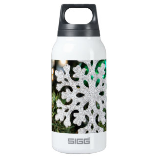 Sparkly snowflake ornament on Christmas tree 10 Oz Insulated SIGG Thermos Water Bottle