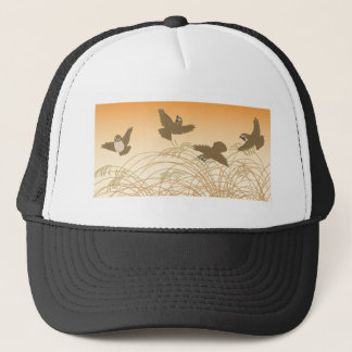Sparrow flying over panicles during fall season trucker hat