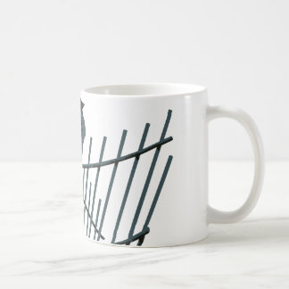 Sparrow on fence - Vector Coffee Mug