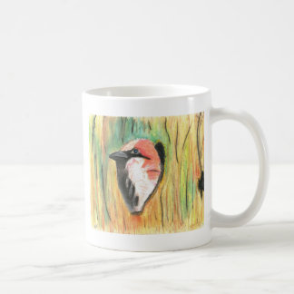 sparrow peaking from a piling coffee mug