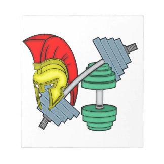 Spartan's helmet on gym equipment notepad