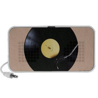 Speaker: Vinyl Record on a Turntable