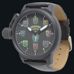 "Special Forces Green Beret Watch<br><div class=""desc"">Special Forces Watch. Black watch and face with hours. Special forces Airborne tabs at center surrounded by the various SF Group flashes with The Oppresso Liber crest. Command, 1st, 3rd, 5th, 7th, 19th, 20th. ***NOTICE*** There are several styles and color of watches with the same face. Price varies with watch....</div>"