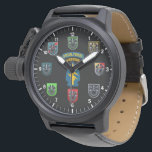 """Special Forces Green Beret Watch<br><div class=""""desc"""">Special Forces Watch. Black watch and face with hours. Special forces Airborne tabs at center surrounded by the various SF Group flashes with The Oppresso Liber crest. Command, 1st, 3rd, 5th, 7th, 19th, 20th. ***NOTICE*** There are several styles and color of watches with the same face. Price varies with watch....</div>"""