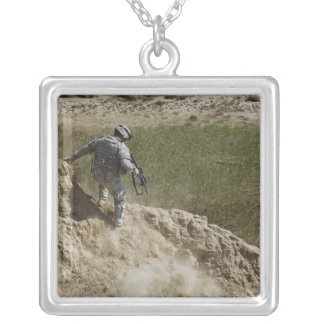 Specialist climbs down square pendant necklace