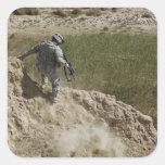 Specialist climbs down square sticker