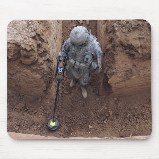 Specialist searches for a weapons cache mouse pad