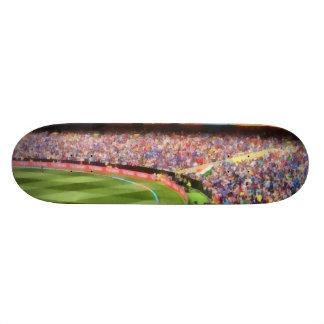 Spectators in a stadium skateboards