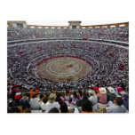 Spectators watching a bullfight in a bullring, post cards