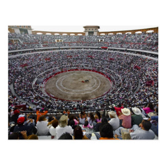 Spectators watching a bullfight in a bullring, postcard