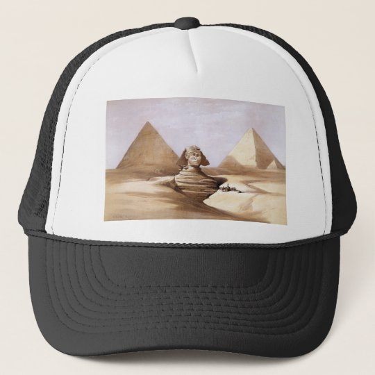 Sphinx in front of the pyramids trucker hat