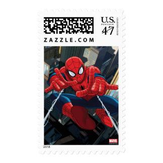Spider-Man que tira alto del Web sobre ciudad Sellos Postales