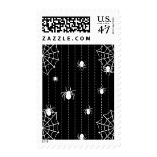 Spiders and web background postage