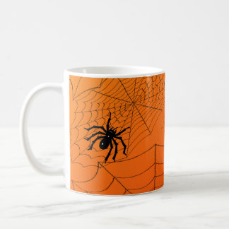 Spiderwebs en el naranja taza de café