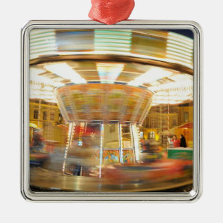 Spinning carousel at night christmas ornament