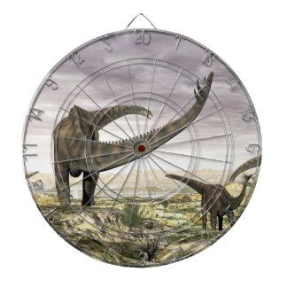 Spinophorosaurus dinosaurs herd in the desert dartboard