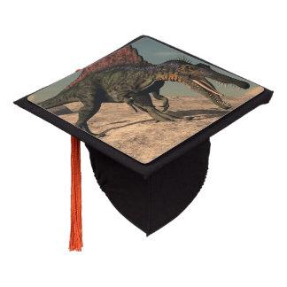 Spinosaurus dinosaur hunting a snake graduation cap topper