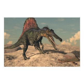 Spinosaurus dinosaur hunting a snake stationery