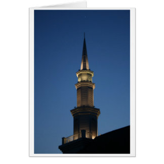 Spire of a building against dark blue twighlight card