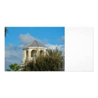 spire roof against blue sky and trees florida photo card template