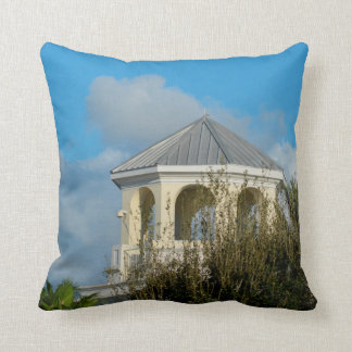 spire roof against blue sky and trees florida throw pillow