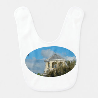 spire roof against blue sky and trees florida baby bib