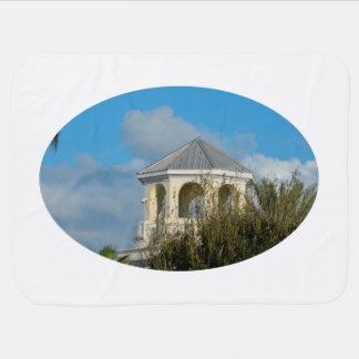 spire roof against blue sky and trees florida baby blanket