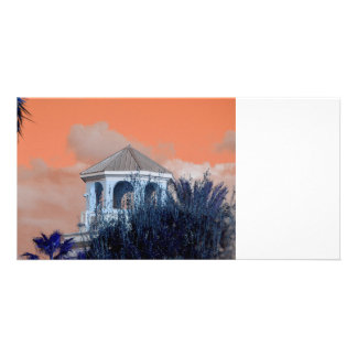 spire roof against orange sky and trees florida photo card