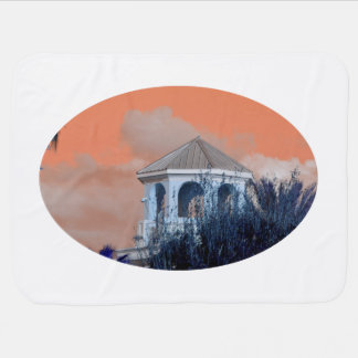 spire roof against orange sky and trees florida baby blankets