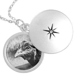 spirits and chickens round locket necklace