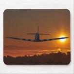 Spitfire flies into the sunrise mousepads
