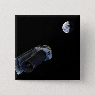 Spitzer points its high-gain antenna pinback button