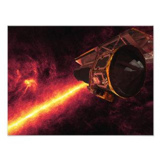 Spitzer visto contra el cielo infrarrojo cojinete