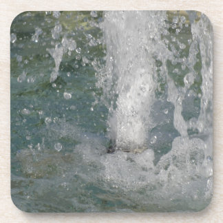 Splashes of fountain water in a sunny day drink coaster