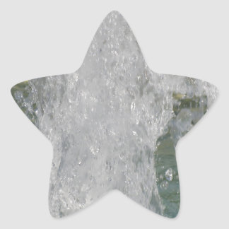 Splashes of fountain water in a sunny day star sticker