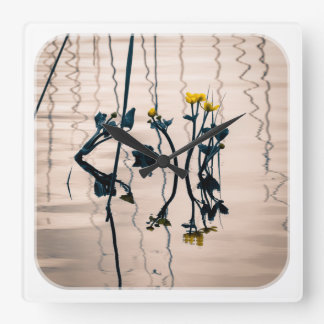 Split-toned kingcup flowers square wall clock