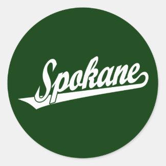 Spokane script logo in white round stickers