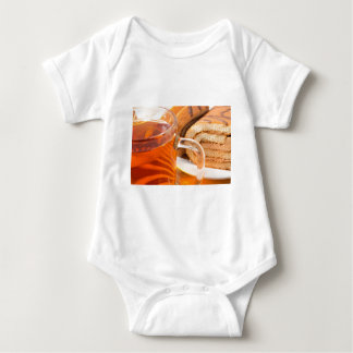 Sponge cake with chocolate filling and tea baby bodysuit