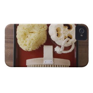 Sponge, loofah, brush on red tray iPhone 4 cover