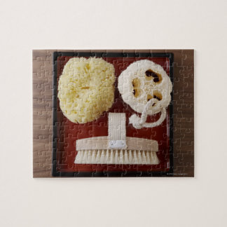 Sponge, loofah, brush on red tray jigsaw puzzle