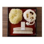 Sponge, loofah, brush on red tray post card