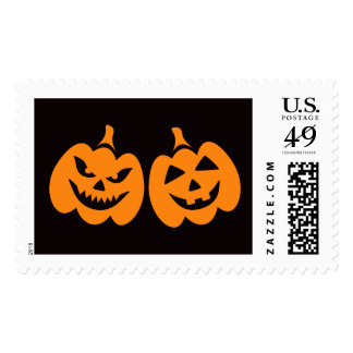 Spooky and happy Halloween Jack o lantern on black Postage Stamps