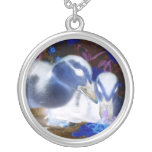 Spooky blue and white baby ducks pendant