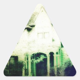 Spooky looking house merchandise triangle sticker