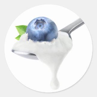 Spoon of blueberry yogurt classic round sticker