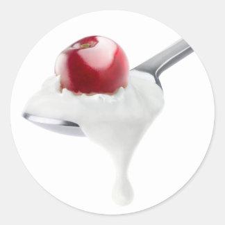 Spoon of cherry yogurt classic round sticker