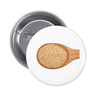 Spoonful of toasted sesame seeds button